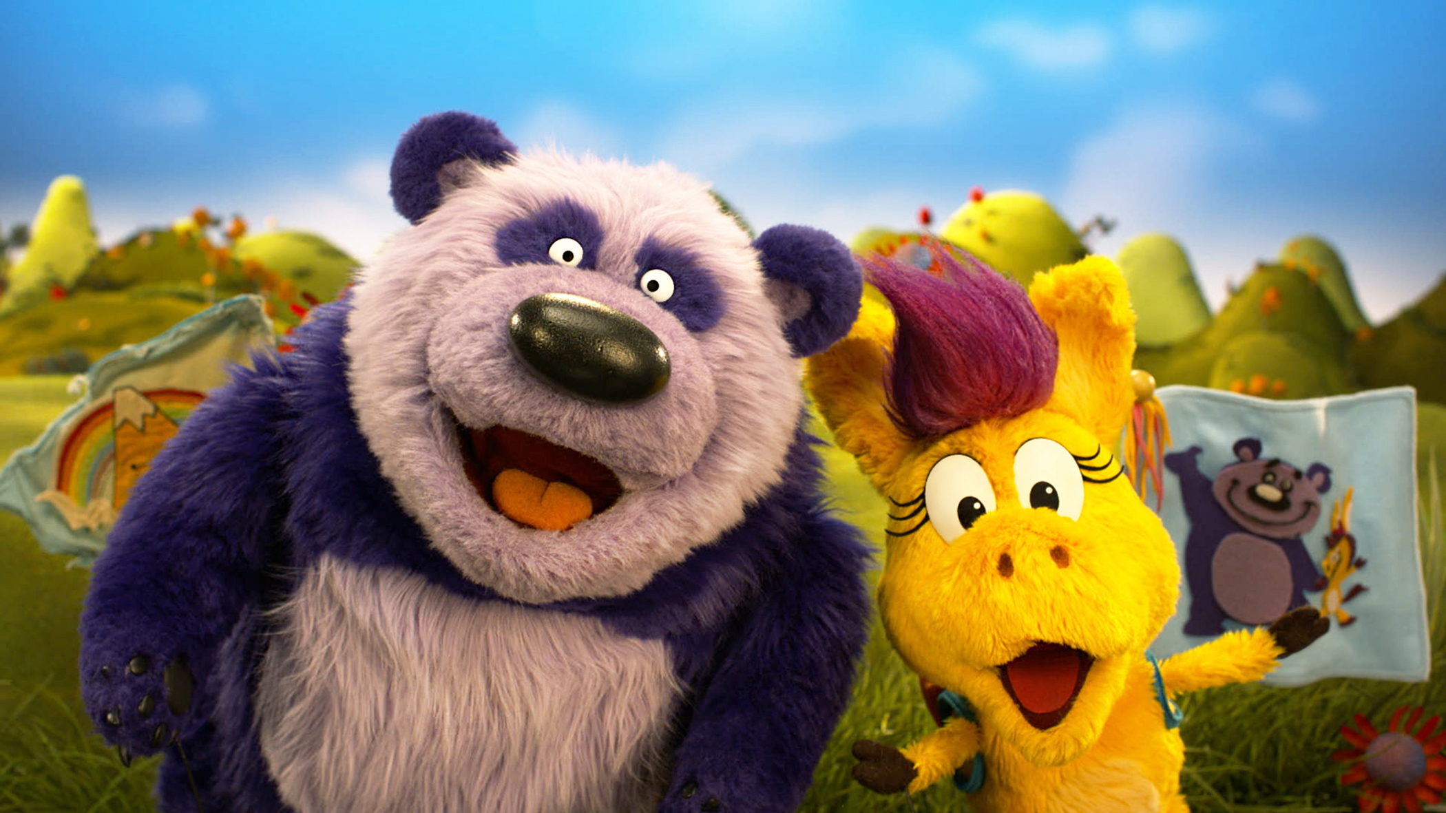 The Purple Panda and Donkey Hodie puppets from the series Donkey hodie.