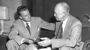 Billy Graham (left) with President Dwight D. Eisenhower, both holding the same Bible. 1957.