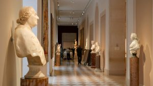 Art handlers move Stone Megalith through the European Sculptures Galleries at The Met Museum, New York.