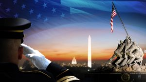 Composite image of American military imagery including a saluting soldier, a U.S. flag, and the United States Marine Corps War Memorial statue.
