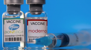 Vials of the Moderna and Pfizer COVID-19 vaccines.