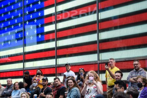 People watch a performance during a pop up event in Times Square on June 11, 2021 in New York City.