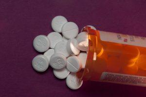An opened bottle of prescription opioids.