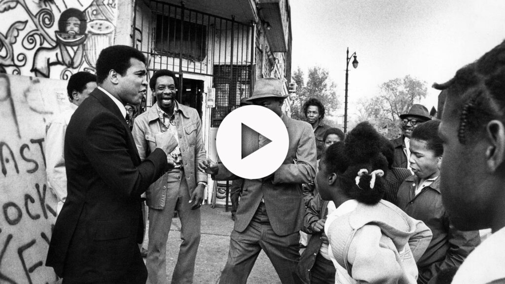 Muhammd Ali on the street with fans.