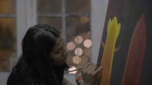 Indiginous painter Rember Yahuarcani working on a painting