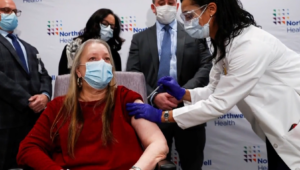 A woman receives the vaccine for COVID-19.