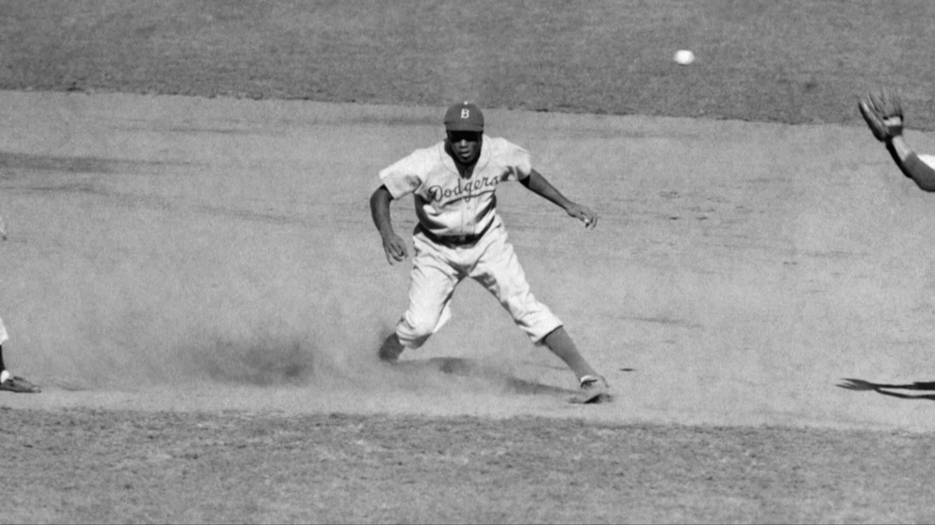 Black and white photo of Jackie Robinson on the field