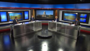 Guest host Lawrence Smith and journalists on the set of Comment on Kentucky.