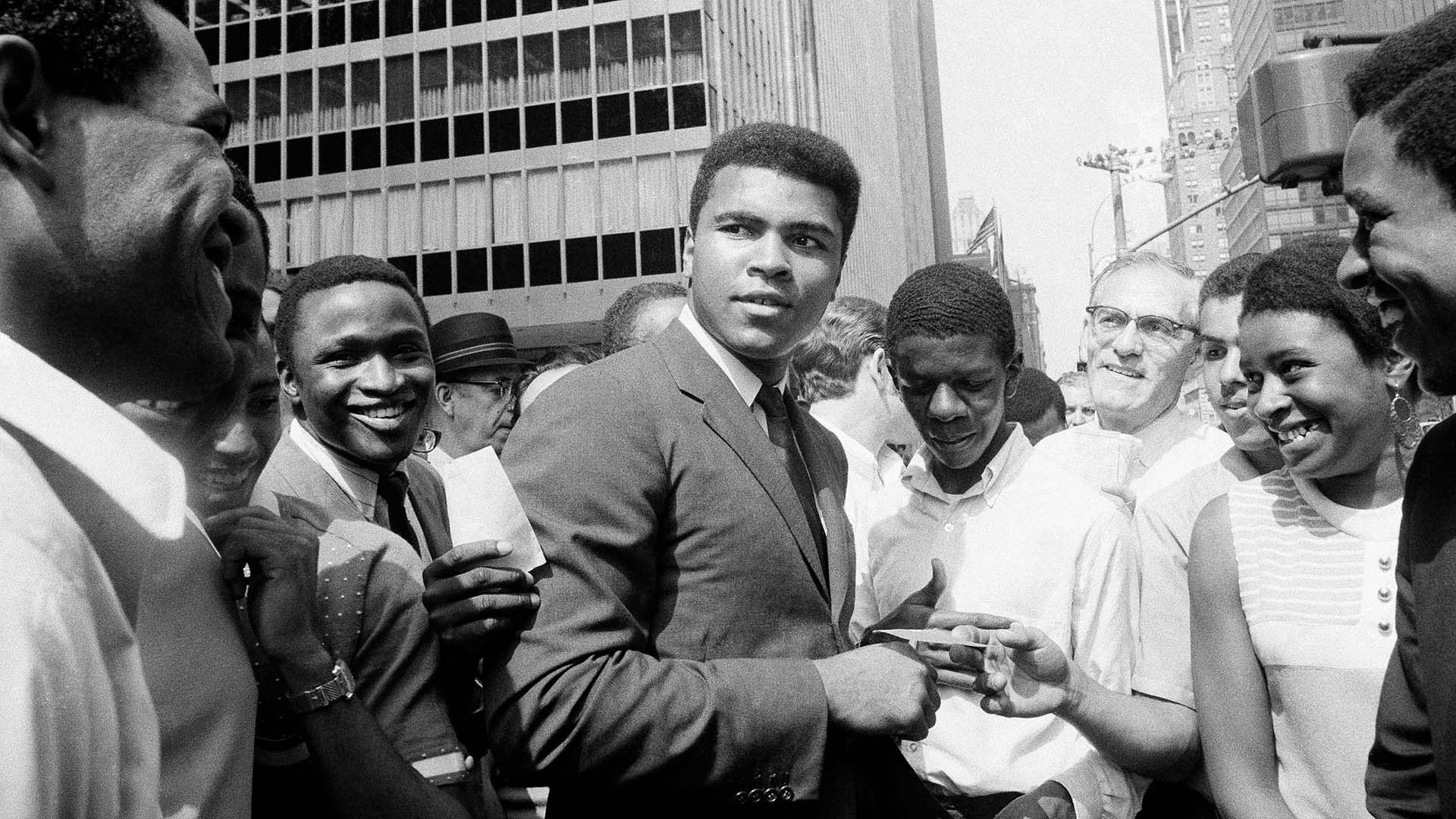 Muhammad Ali, is surrounded by autograph seekers at 51st Street and Sixth Avenue in Manhattan, New York. August 23, 1968.