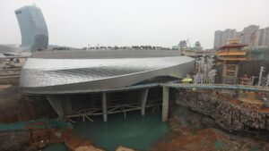 Ice World, a huge, disc-shaped silver building, under construction